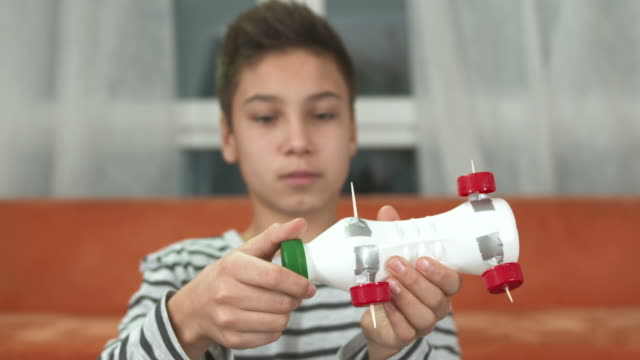 hd: boy made a recycling toy car - plastic cap stock videos & royalty-free footage