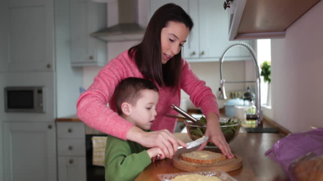 boy making a sandwich with mother helping - making a sandwich stock videos and b-roll footage
