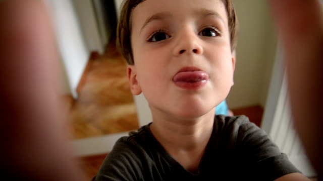 Boy making faces. Pov.