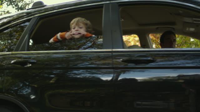 ms pan boy (4-5) making funny faces through car window / atlanta, georgia, usa - pulling funny faces stock videos & royalty-free footage