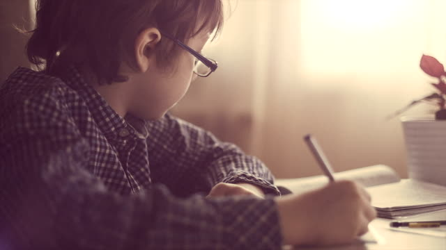 boy making his homework - homework stock videos & royalty-free footage
