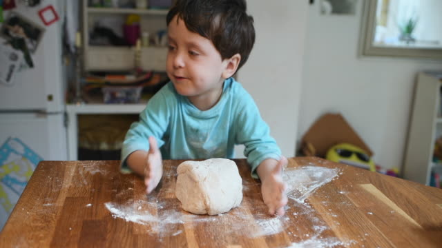 boy making pizza - all shirts stock videos & royalty-free footage