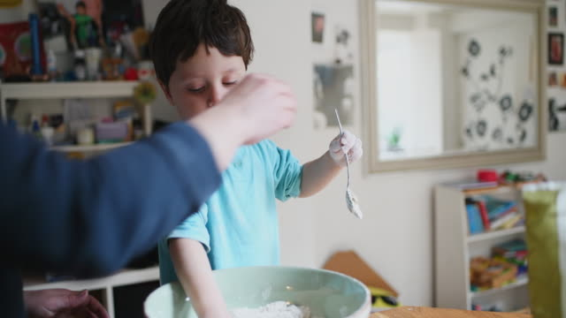 boy making pizza - mixing bowl stock videos and b-roll footage
