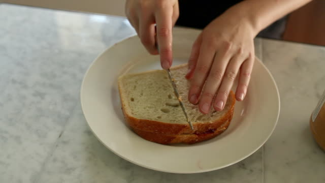 boy making sandwich and licking knife - cut video transition stock videos & royalty-free footage