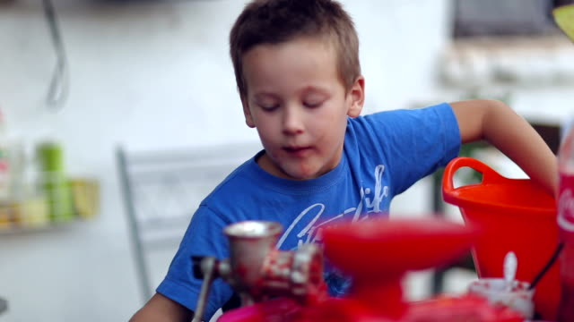 boy making tomato juice - tomato juice stock videos and b-roll footage