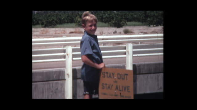1966 boy near warning sign - gefahr stock-videos und b-roll-filmmaterial