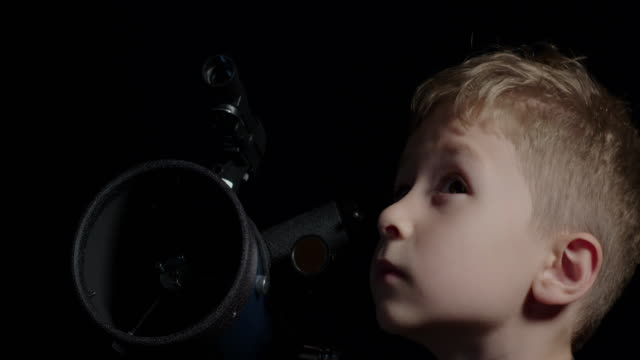 boy observing the night sky - children only stock videos & royalty-free footage
