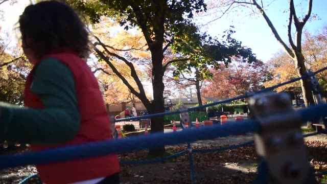 a boy on a bridge at the park. - children only stock videos & royalty-free footage