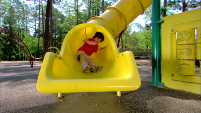boy on a slide - see other clips from this shoot 1428 stock videos & royalty-free footage