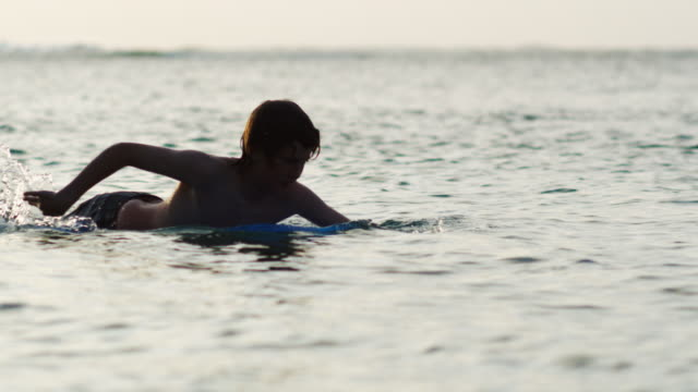 boy on a surfboard - one teenage boy only stock videos & royalty-free footage