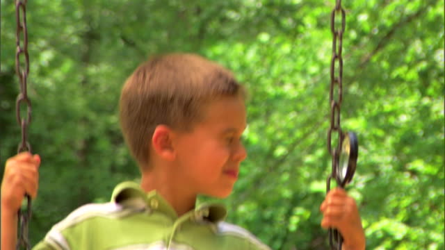 boy on a swing with a magnifying glass - see other clips from this shoot 1428 stock videos & royalty-free footage