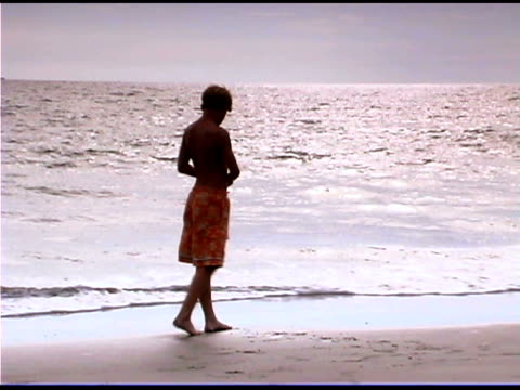 boy on beach - see other clips from this shoot 1335 stock videos and b-roll footage