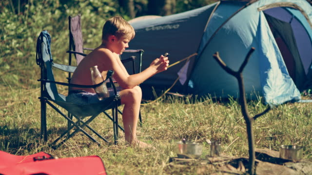 boy on camping - barefoot stock videos & royalty-free footage