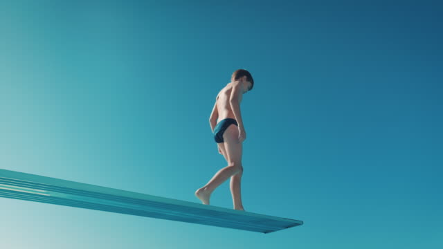 Boy on diving board