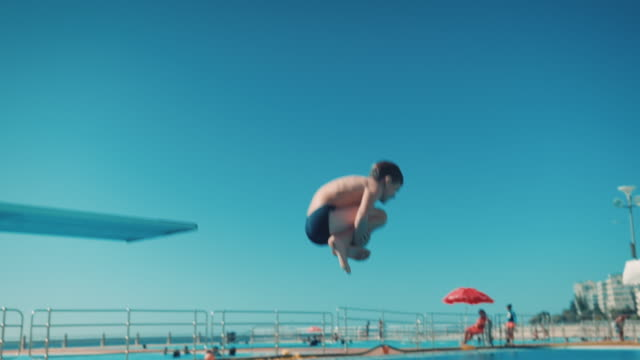 boy on diving board - jumping stock videos & royalty-free footage