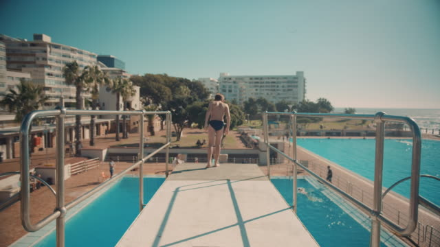 Boy on diving board