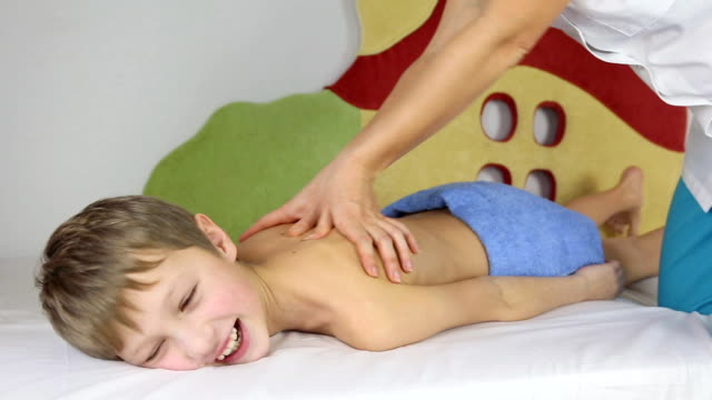 boy on massage - massaging stock videos and b-roll footage
