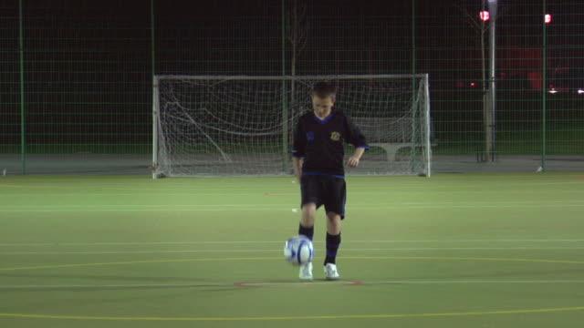 ws boy (14-15) on soccer field doing keep-ups, london, uk - juggling stock videos & royalty-free footage