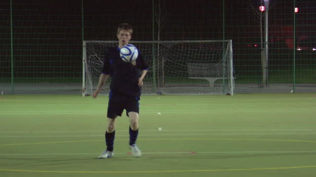 ws boy (14-15) on soccer field doing keep-ups, london, uk - juggling stock videos & royalty-free footage