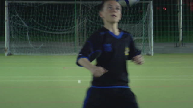 ms tu boy (14-15) on soccer field doing keep-ups, london, uk - one teenage boy only stock videos & royalty-free footage