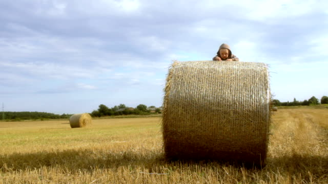 boy on straw bale 6096 - bale stock videos and b-roll footage