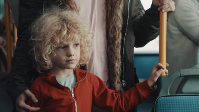 pojke på bussen - spårvagn bildbanksvideor och videomaterial från bakom kulisserna