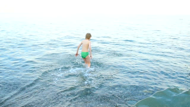 boy on the sea in cold weather
