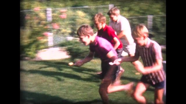 stockvideo's en b-roll-footage met 1964 boy opening birthday presents and egg race - verjaardagskado