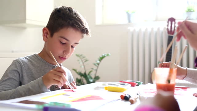 boy painting at home - coloring stock videos and b-roll footage