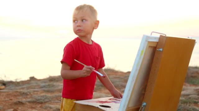 boy paints - easel stock videos and b-roll footage