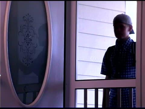 boy peeking in door - dreiviertelansicht stock-videos und b-roll-filmmaterial
