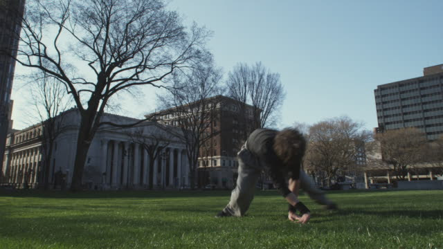 ws la boy (16-17) performing exercises in park, new haven, connecticut, usa - new haven stock-videos und b-roll-filmmaterial