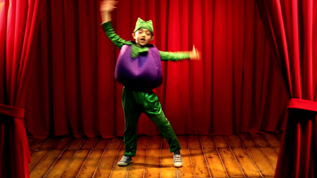 ms boy performing on stage wearing aubergine costume during annual day - stage costume stock videos & royalty-free footage