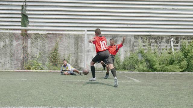 boy play soccer game, - scoring stock videos & royalty-free footage