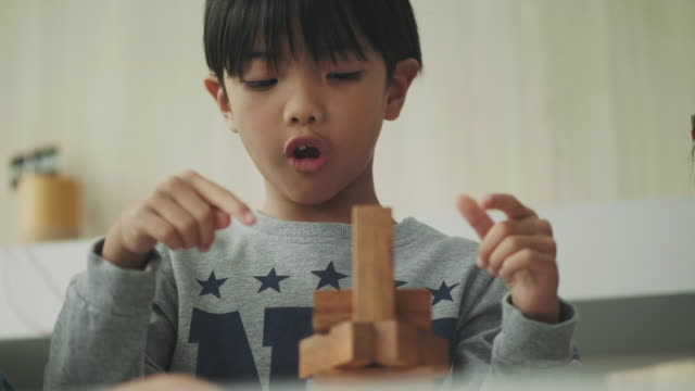boy play wood block - block shape stock videos & royalty-free footage