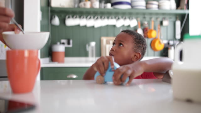 boy playing at breakfast time - busy morning stock videos & royalty-free footage