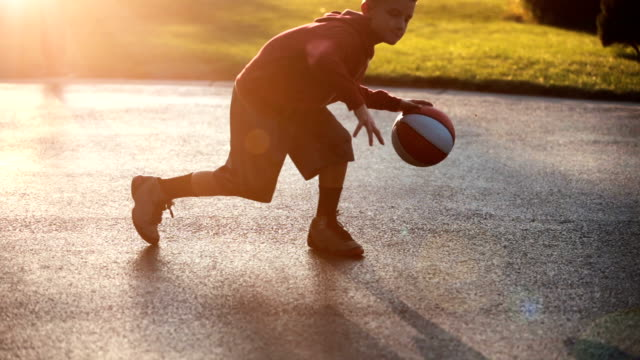boy playing basketball - basketball ball stock videos & royalty-free footage