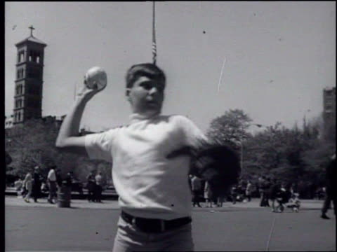 Boy playing catch in Washington Square Park