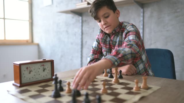 boy playing chess alone - skill stock videos & royalty-free footage