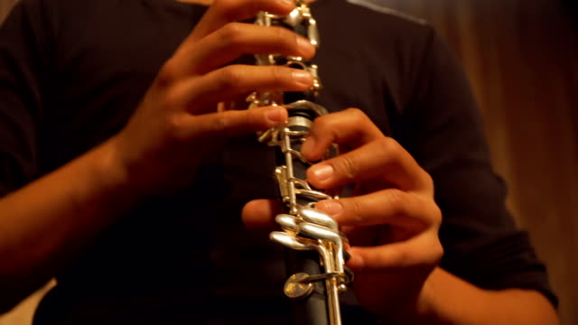 boy playing clarinet in concert - clarinet stock videos & royalty-free footage
