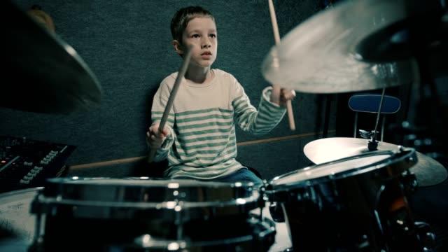 Boy playing drums