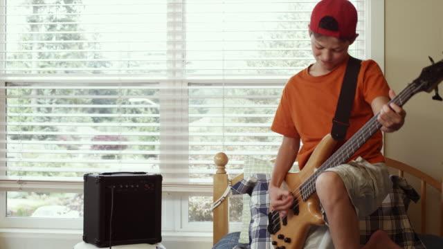 MS PAN Boy (12-13) playing electric guitar / Renton, Washington, USA