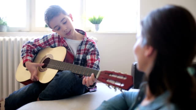 boy playing guitar - plucking an instrument stock videos & royalty-free footage