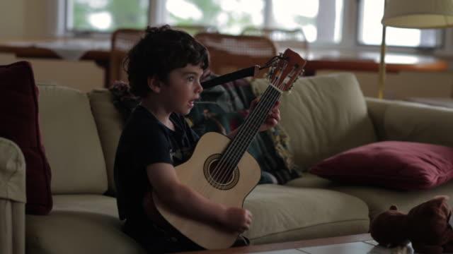 MS Boy playing guitar / WOLFEBRO, NH, USA