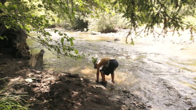 ws boy (4-5) playing in creek, big sur, california, usa - children only stock videos & royalty-free footage