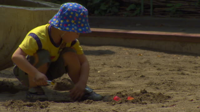 ws boy playing in sandbox, tokyo, japan - sand pit stock videos and b-roll footage