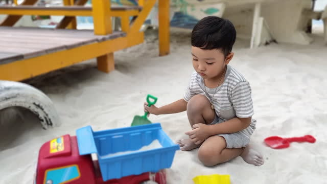 a boy playing in the sand alone - toddler stock videos & royalty-free footage