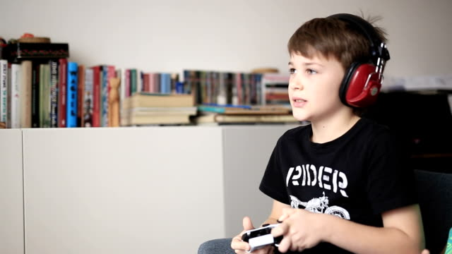 boy playing on games console - liquid crystal display television stock videos and b-roll footage