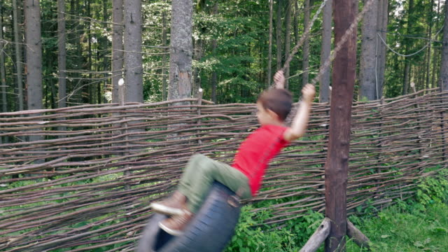 boy playing on tire swing - tyre swing stock videos & royalty-free footage