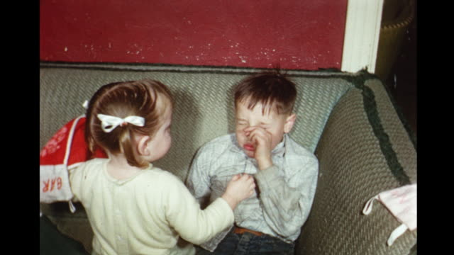 1956 HOME MOVIE Boy playing piano and sister bothering sleepy brother / Toronto, Canada
